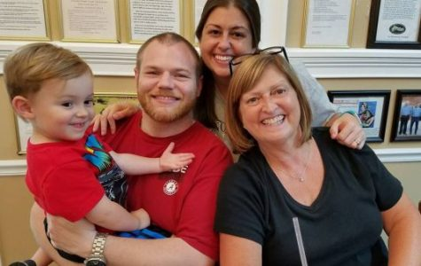 MRS. MOORE LOVES SPENDING TIME WITH HER FAMILY -- Mrs. Moore (far right) spends some quality time with her grandson, Wyatt Hawkins (far left), her son-in-law, Jason Hawkins (center left), and her daughter, Paige Hawkins (center right).