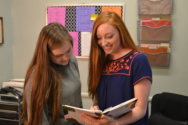 CENTRAL WELCOMES MS. HENSLEY -- (Left to right) Senior Michelle Caszatt and Shea Hensley discuss schedules.