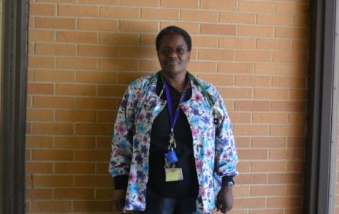 TEACHER SPOTLIGHT: CENTRAL HIGH SCHOOL WELCOMES NEW NURSE, KIM LYKES -- New nurse, Kim Lykes, posing for a picture next to the gym.