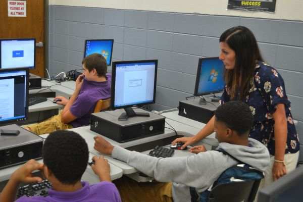 MS. WARE SHOWS STUDENTS MICROSOFT WORD -- Ms. Ware teaches students to use Microsoft, which they will use all throughout the year.