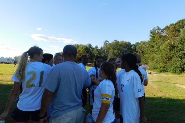 HUDDLE TIME -- Girls soccer team huddles before second half