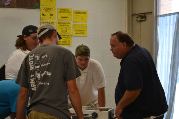 TEACHER SPOTLIGHT: CENTRAL HIGH WELCOMES NEW MECHANICS AND CONSTRUCTION TEACHER MR. WEBB -- Mr. Webb helps a group of his students work on their first project of the year