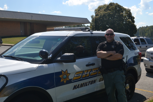 NEW SRO FOR CENTRAL HIGH SCHOOL-- Sgt. Merkle poses next to his patrol car.