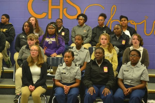 CENTRAL CHOIR WARM-UP --  Choir gets ready for the upcoming festival.