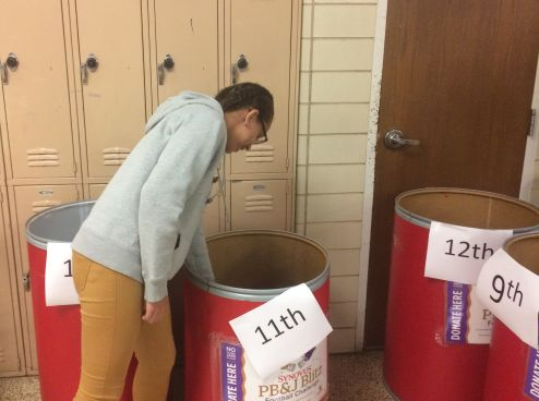 CENTRAL HIGH COLLECTS WINS PEANUT BUTTER AND JELLY BOWL -- Junior Alexis Massengale donates her jar of peanut butter to help out those affected by Hurricane Harvey.
