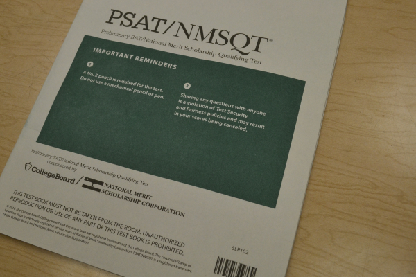 SOPHOMORE AND JUNIORS TAKE THE PSAT ASSESSMENT-- A PSAT practice testing booklet used to help students study