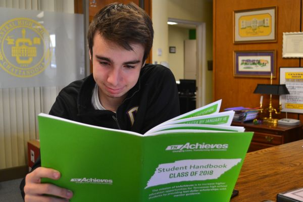 SENIORS NEED TO APPLY FOR THE TENNESSEE PROMISE-- Senior Brandon Irving reads the TN Promise handbook.