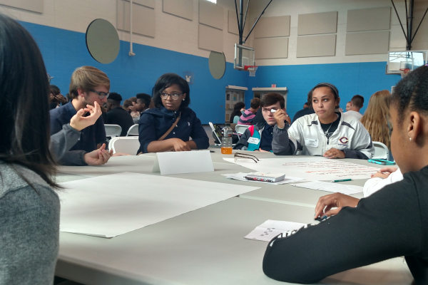 STUDENTS REPRESENT CENTRAL AT THE SUPERINTENDENT STARS MEETING -- Central students are depicted contributing ideas as a team.