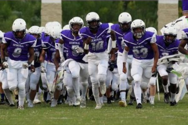 CONCUSSION ARE A WORRY AT CENTRAL HIGH SCHOOL -- Central's football team running in at the start of a football game.