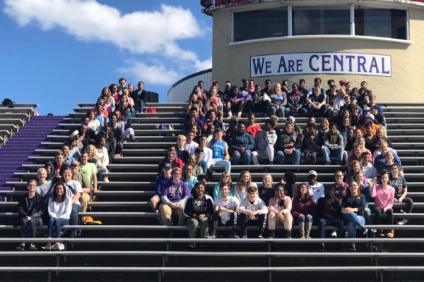 SENIORS BUNDLE UP FOR SENIOR PICNIC DAY -- Seniors continue the tradition of forming their graduation year in the football field bleachers.