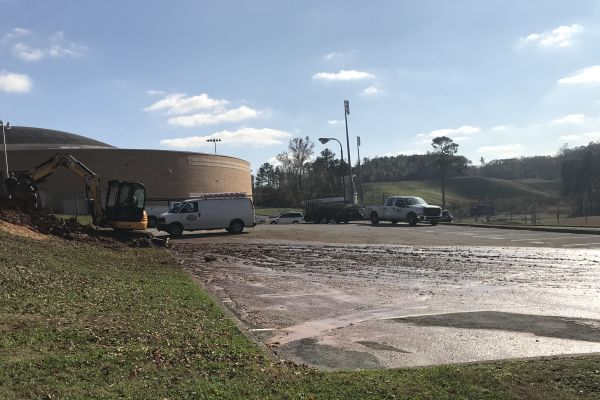 PIPE BURST CAUSES FLOODING -- The parking lot outside of C- Pod was covered in water and mud after a burst in the water pipes.