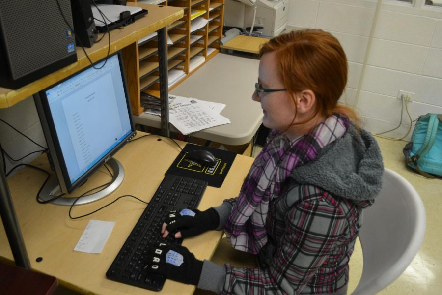 THE WOES OF APPLYING TO COLLEGE -- Kat Cimino Working on One of Many Papers for College