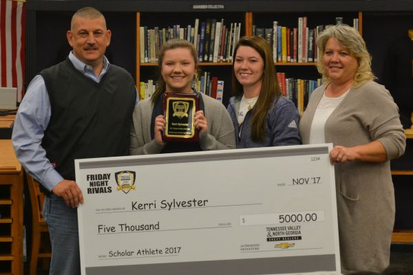 KERRI SYLVESTER EARNS SCHOLARSHIP FOR HARD WORK -- Kerri Sylvester poses with her family and $5000 scholarship check