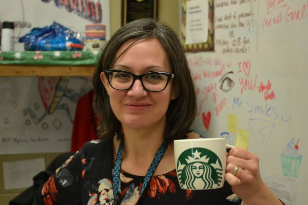 A CUP A DAY -- English Teacher Sally White poses with her Starbucks cup.