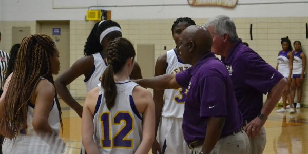 CENTRAL HIGH LADIES BASKET BALL ACCEPTS THEIR WINS AND LOSES AS THE SEASON BEGINS --The girls basketball team getting ready for the game to begin.