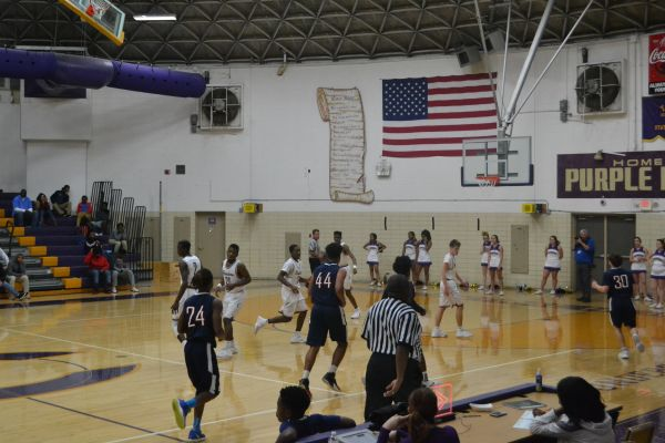 BOYS BASKETBALL TEAM TAKES LOSS TO EAST RIDGE, BUT IS READY TO WORK HARD TO ACHIEVE MORE WINS THIS SEASON-- The boys basketball team sadly lost the game, but they're not going to let that discourage them this season.