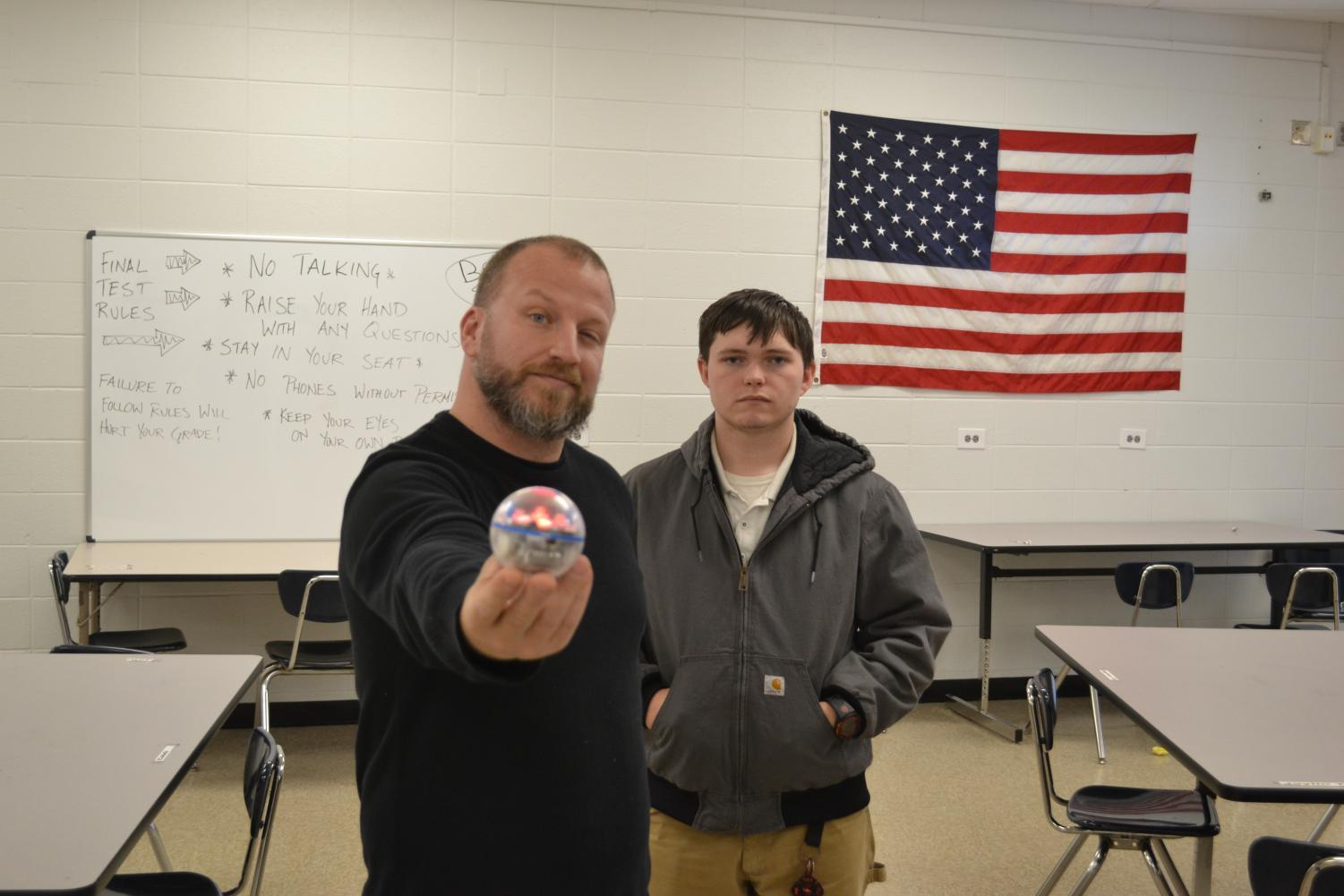 MECHATRONICS IF FLOURISHING IN FIRST YEAR AT CENTRAL -- Mr. King (left) and  Gavin Rampagos (right) show off one of the Sphero balls