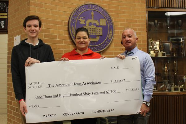 (Left to right) Editor-in-Chief Preston Fore, American Heart Association East Tennessee Senior Youth Market Director Jean Saunders, and Principal Finley King display's Central's donation to the Heart Association.