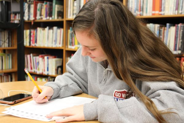 JUNIORS GEAR UP FOR THE ACT-- Junior Emily Miller works on a practice ACT
