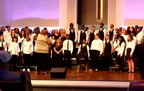 BOUTWELL'S LAST CENTRAL CONCERT -- Mrs. Boutwell directs the Freshman and Concert choirs in their last concert with her.