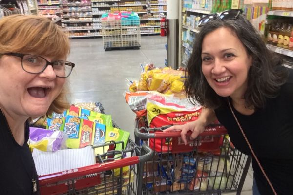 ENGLISH TEACHER SALLY WHITE VOLUNTEERS AT MEXICAN BORDER OVER THE SUMMER -- Mrs. White and her best friend, Alice, purchasing items to donate.