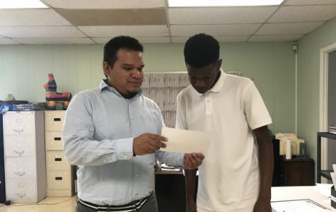 TEACHER SPOTLIGHT: CENTRAL SAYS 'BIENVENIDO' TO NEW SPANISH TWO TEACHER, SALVADOR PINA -- New Spanish teacher, Salvador Pina, helps his student, Brian McKibben, with his Spanish work.