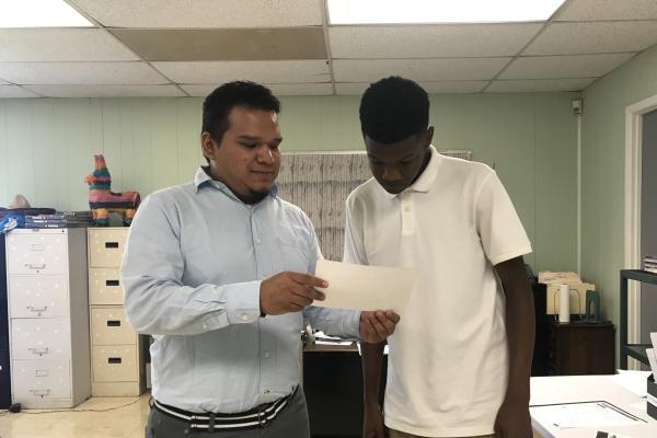 TEACHER SPOTLIGHT: CENTRAL SAYS BIENVENIDO TO NEW SPANISH TWO TEACHER, SALVADOR PINA -- New Spanish teacher, Salvador Pina, helps his student, Brian McKibben, with his Spanish work.