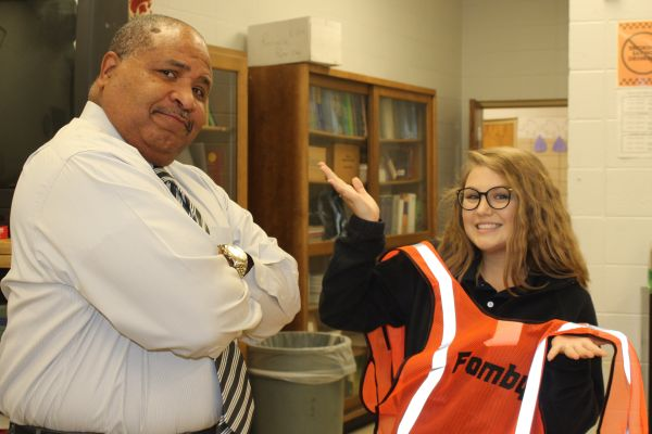 CENTRAL'S NEXT TOP CONSTRUCTION WORKER -- Columnist Laurelie Holmbeg is scolded by biology teacher, Mr.Fomby.