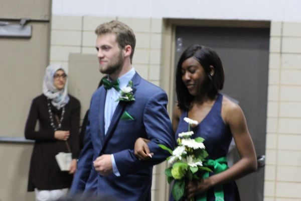 SENIOR DAY HOPEFULS WALK THE AISLE -- Mitchell O'neil (left) and Taya Crowder (right) walk toward the stage for senior day crowning.