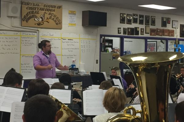 TREVOR WHITE JOINS CENTRAL FAMILY AS BAND STUDENT TEACHER -- Mr. White leads the band in a warm-up chorale before they start to work on the harder, more technical music.