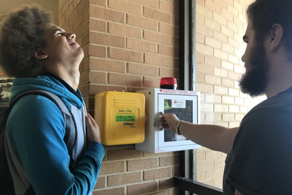 AEDS INSTALLED AS A RESULT OF NEW BILL BEING PASSED -- Students analyze new AED and Epi-pen's established near the front entrance.