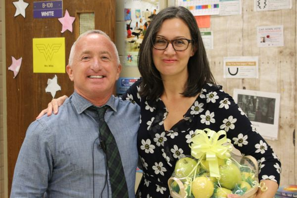 SALLY WHITE WINS WDEF GOLDEN APPLE AWARD -- Principal Finley King presents White with her basket of apples.