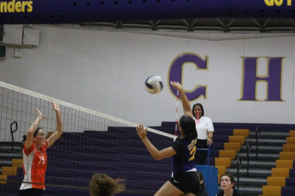 THE LADY POUNDERS PREVAIL AGAINST THE  EAST RIDGE PIONEERS -- Jasmine Mosley(Right)  spiking the ball against Megan Hiu (Left)