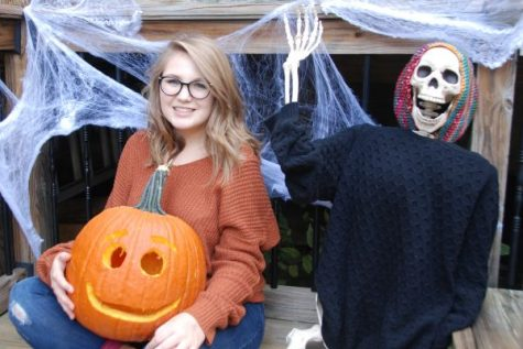 TWO TRUTHS, ONE LAURELIE: SPOOKY SEASON-- Columnist poses with her completed pumpkin.