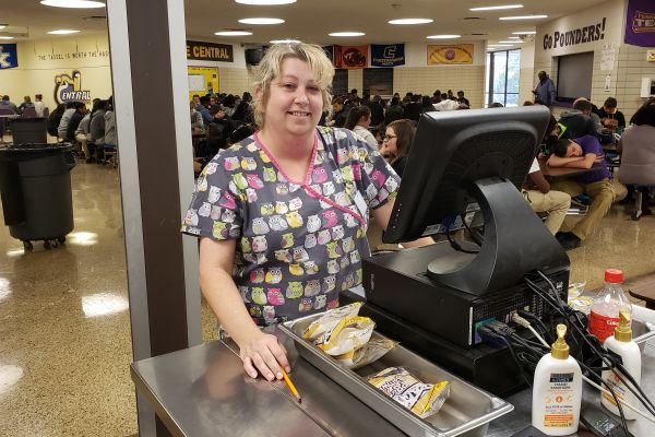 SCHOOL CAFETERIA MANAGER JENNIFER MCNABB GIVES LUNCH FOOD AN UPGRADE -- Jennifer McNabb serving kids during lunch at the registers.