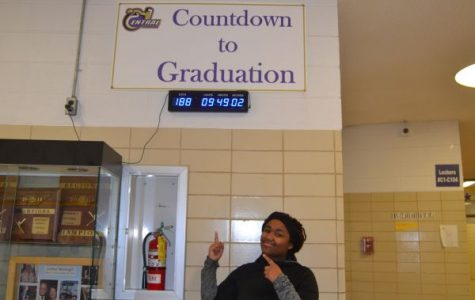 ADMINISTRATION ANNOUNCES NEW GRADUATION DATE -- Senior enthusiastically points out the countdown to graduation.