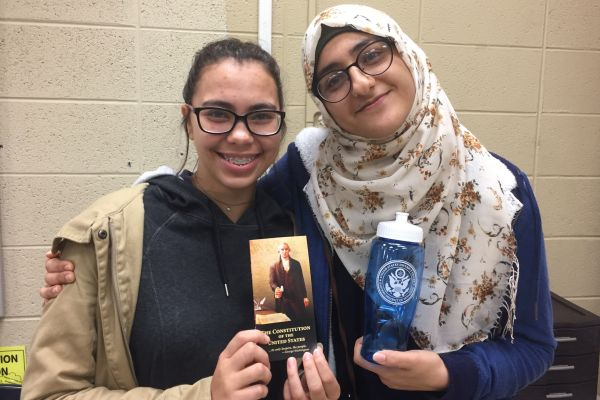 AP GOVERNMENT STUDENTS GET A GLIMPSE INSIDE FEDERAL COURT -- (Left to right) Seniors Deanna Wnuk and Zeena Whayeb enjoy their free pocket Constitution and water bottle from federal court.