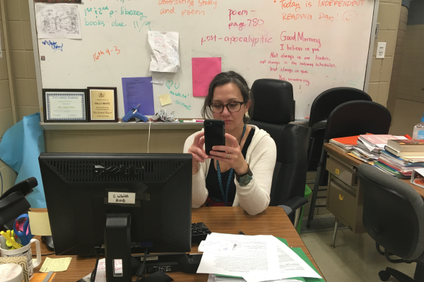 CENTRAL'S SOCIAL MEDIA STRUGGLE -- English teacher, Ms. Sally White, looking over her phone in deep thought about social media.