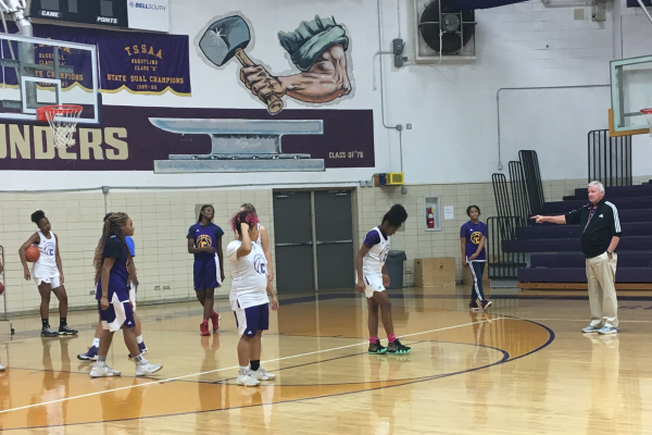 THE GIRLS' BASKETBALL TEAM AIMS TO SCORE BIG THIS 2018-2019 SCHOOL YEAR -- Coach Rick May gives out advice to The Lady Pounders to help them improve during practice.