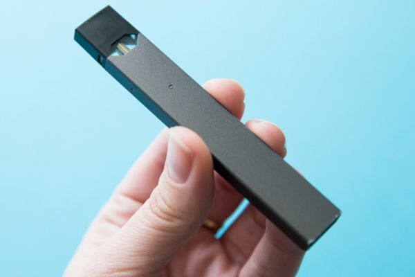 EDITORIAL: IS VAPING AN ISSUE IN HAMILTON COUNTY SCHOOLS? --- A vaper holding up a popular brand of vape called a Juul.