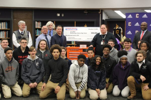 CENTRAL'S SKILLED TRADES CLASSES RECEIVES $50,000 PRIZE -- Jerry Webb and his students were presented with the check along with school officials and a Harbor Freight representative.