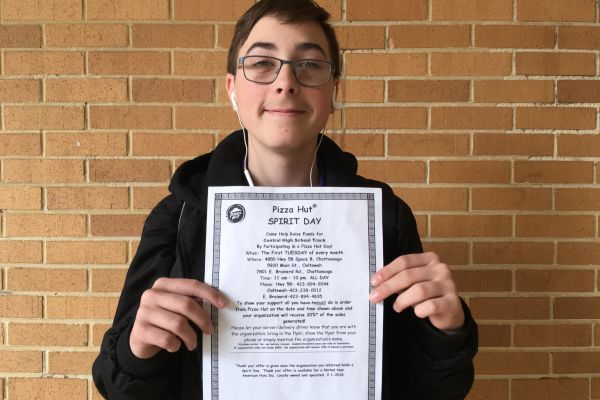 CENTRAL'S TRACK TEAM PARTNERS WITH PIZZA HUT TO CREATE FUNDRAISER--  Freshman Jaiden Hutton holds up one of the many fliers that are hung around Central HIgh School for the Track Team's partnered fundraiser.