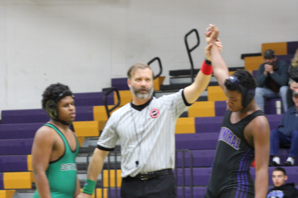 EIGHT WRESTLERS HEADING TO STATE -- Central wrestler declared victorious at match earlier this year.