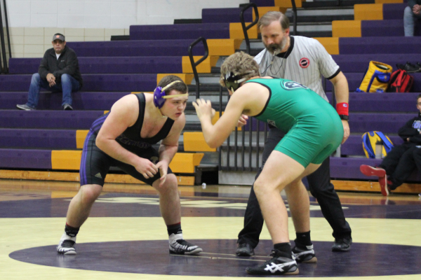 CENTRAL'S 2018-19 WRESTLING TEAM ANTICIPATES SUCCESSFUL SEASON — Junior Donavyn Walker faces off the opposing team member after doing a cordial introductory handshake.