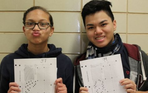 SHOULD STUDENTS BE SEGREGATED IN SCHOOL BASED ON ABILITY? -- Alexis Massengale (left) and Matthew Phan (right) show off their contrasting grades.