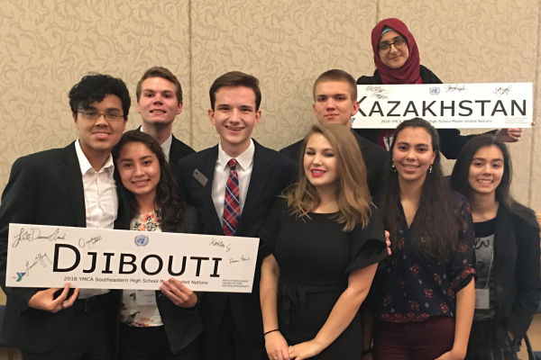 STUDENTS REPRESENT CENTRAL AT ANNUAL MODEL UNITED NATIONS CONFERENCE -- Central students representing either Djibouti or Kazakhstan at 2018's Model UN. From left to right: Hanton Guerrero, Cassandra Castillo, Jake Johns, Preston Fore, Laurelie Holmberg, Matthew Frazier, Zeena Whayeb, Deanna Wnuk, and Danae Wnuk. File Photo from 2018.