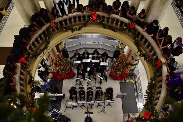 CENTRAL'S MUSIC DEPARTMENT SPREADS HOLIDAY CHEER WITH CHRISTMAS AT THE COURTHOUSE PERFORMANCE -- Central's Jazz Band and Choir pose for a photo in the rotunda of the Hamilton County Courthouse during the annual