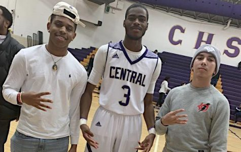 SENIOR CHEERLEADERS AND BOYS BASKETBALL PLAYERS ANTICIPATE LIFE AFTER CENTRAL -- Senior Davon Reid poses with Central fans after the boys basketball victory over Hixson.
