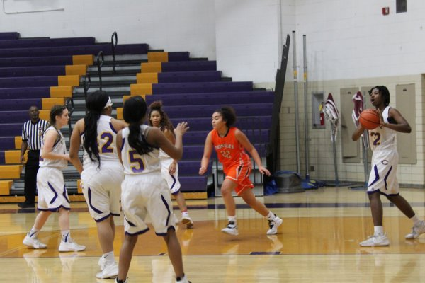 LADY POUNDERS BASKETBALL TEAM LOOKS BACK ON THIS SEASON'S ACHIEVEMENTS -- Central's girls basketball teammates work together to score a basket.