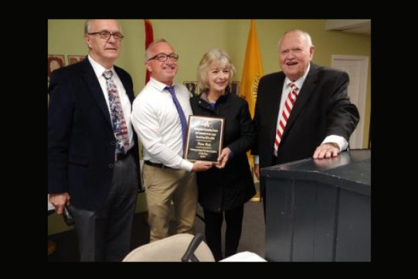 PRINCIPAL FINLEY KING IS PRESENTED WITH FREEDOMS FOUNDATION DISTINGUISHED EDUCATOR AWARD -- From left to right: Clerk Larry, Principal Finley King, Diane Hale, and Gene Pike pose after presenting King and Hale with awards from the Freedom's Foundation.